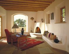 "stylish-homes: "" Southwest Adobe Reading Room with a Kiva Fireplace, Santa Fe """