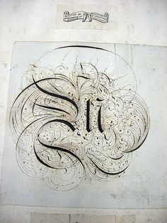 1800s Lettering Sketchbook -This flourished fraktur capital letter M was pasted into a sketchbook of romantic and medial lettering (traces, copies?) that some wonderful British gentlemen put together during the nineteenth century.