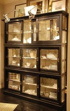 Furniture at Nell Hill's Briarcliff -  A fresher take on the china cabinet. Pharmacy lamps are secured to the top of the to provide lighting.
