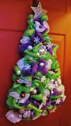 Beautiful deco mesh Christmas tree wreath for holiday decorating. Though not traditional Christmas colors, the colorful purple, blue and green theme is really unique!