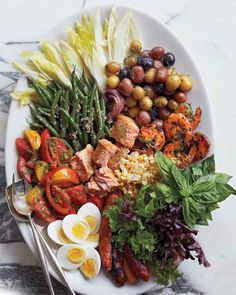 Leftover Salade Nicoise | Martha Stewart Living - This composed salad is made from leftover salmon; shrimp; and whatever raw, grilled, or blanched vegetables you have on hand. The beauty is, it doesn't matter if you have two shrimp or 10, half an avocado or two. Use what you have -- the more varied it is in color and texture, the more impressive it will look.