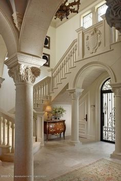 Traditional Entryway with specialty window, Chandelier, Crown molding, Transom window, travertine floors, Arched window, Loft