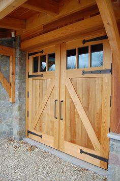 Looking more closely at the garage doors the strap hinges and heavy steel handles contrast against Western Red Cedar wood. D24 Wooden Garage Doors, Garage Door Colors, Garage Door Design, Garage Door Windows, Diy Garage Door, Barn Door Garage, Garage Shop, Exterior Barn Doors, House Doors