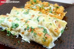These are the BEST  chicken enchiladas I have EVER  eaten.  I am talking restaurant quality!  I have never been a fan of the popular chic...