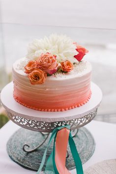 ombre peach cake, photo by Steve Cowell Photo http://ruffledblog.com/encinitas-beach-wedding #weddingcake #cakes
