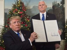 Saul Loeb - US President Donald Trump holds up a signed memorandum after he delivered a statement on Jerusalem from the Diplomatic Reception Room of the White House in Washington, DC on December 6, 2017 • Donald Trump recognized Jerusalem as Israel's capital  — a historic decision that overturns decades of US policy and risks triggering a fresh spasm of violence in the Middle East.http://www.breitbart.com/jerusalem/2017/12/06/jerusalem-israel-capital-embassy-trump-white-house/