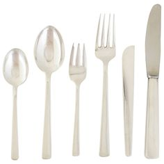 Codan Sterling Silver Modern Flatware Set for Eight | From a unique collection of antique and modern tableware at https://www.1stdibs.com/furniture/dining-entertaining/tableware/