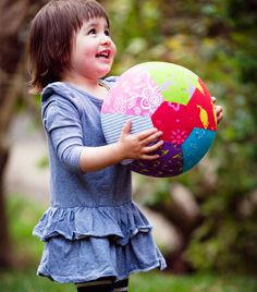 All children love to play with balloons as much as they love to play with balls, and that is why the Goldfish Balloon Ball is the perfect toy for children of all ages. The balloon ball features brightly coloured material cover that fits neatly over the deflated balloon. Simply insert the balloon into the button hole, blow up the balloon and tie up the end and voila, you have your very own safe balloon ball. Folds flat when the balloon is taken out, ethically handmade by Goldfish Gifts Child Smile, Child Love, Your Child, Button Hole, Make Happy, The Balloon, Goldfish, Gifts For Kids, Kids Toys