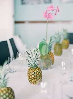 Tropical tablescape with pineapples. Get through the winter blues by throwing a tropical party! Tropical Wedding Decor, Tropical Party, Maui Weddings, Island Weddings, Pineapple Centerpiece, Orchid Centerpieces, Simple Centerpieces, Island Theme, Luau Birthday