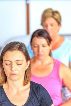 Practicing breathing yoga on Living Empowered Retreats, Mullumbimby