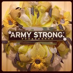 This is a special request custom made Army Strong yellow ribbon deco mesh burlap wreath for a mother that has a son serving in Afghanistan.