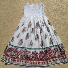 Dress Super cute, lightweight, 100% cotton, strapless dress. It's about 29 inches long and is also lined at the bottom. The top part isn't lined so you would have to wear a bandeau underneath. This is a medium, but would best fit x- small to small! RUNS SMALL. Washed once, never worn. Too small for me. Great condition!! Cristina Love Dresses Strapless