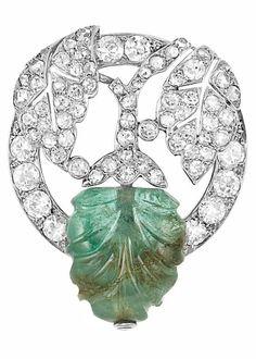 Platinum, Diamond, and Carved Emerald Brooch Marchak, Paris circa 1910.