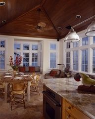 British Colonial kitchen/dining area by Cooper Johnson Smith Architects and Town Planners