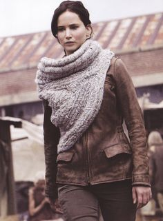 Katnis wears an asymmetrical cowl over a jacket in Hunger Games Catching Fire.
