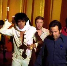 """Richard Davis and Joe Esposito exiting the stage after his performance in """"Elvis: That's The Way It Is"""" in 1970."""