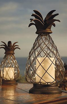 Pineapple Hurricane Lanterns are great for the backyard! Note to self:make pineapple finials Hurricane Lanterns, Candle Lanterns, Outdoor Candles, Outdoor Lighting, Rustic Lanterns, Backyard Lighting, Outdoor Walls, Outdoor Rooms, Outdoor Furniture