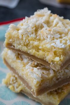 Buttery Coconut Bars have a shortbread-type crust topped with a rich coconut layer. Coconut Candy, Coconut Desserts, Coconut Bars, Coconut Recipes, Healthy Desserts, Easy Desserts, Delicious Desserts, Dessert Recipes, Yummy Food