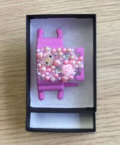 Pink Phone Buddy with Hello Kitty, flowers and gems. Why not create your own www.phone-buddy.co.uk Create Your Own, Create Yourself, Hello Kitty, Gems, Phone, Frame, Flowers, Home Decor, Art
