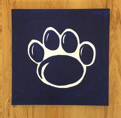 Show your Penn State pride! This 12x12 acrylic painting on stretched canvas features the iconic lion paw.  To order in sets of 4 or 6 paintings,