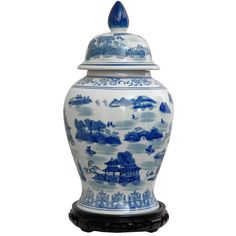 Featuring a traditional Chinese landscape, this magnificent handcrafted porcelain temple jar incorporates blue and white hues for stunning artistic appeal. Measuring 18 inches high and 10 inches in diameter, this lovely accent piece is sure to please.