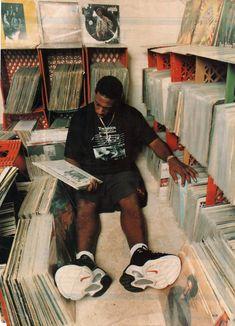 A genius at work. Hip-hop super-producer Pete Rock diggin' through the crates. A genius at work. Hip-hop super-producer Pete Rock diggin' through the crates.