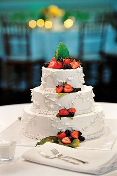 Berry Wedding Cake - Uniquely Southern Wedding Cakes - Southernliving. The wedding cake, decorated with berries, was part of the reception's dessert bar.    Love It? Get It!Hot Cakes