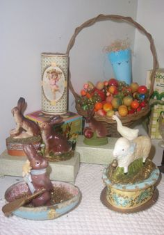 Another vignette from my shelves. The foreground features 2 papier mache' candy containers I made in 1998.
