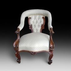 VICTORIAN CARVED ROSEWOOD FRAMED UPHOLSTERED OPEN ARMCHAIR