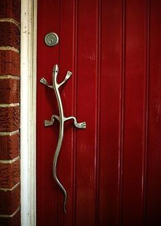 Lizard handle on blood red door - it reminds me of my parents front door. They have a forearm and hand carved out of bog oak as a handle. The Doors, Cool Doors, Unique Doors, Windows And Doors, At The Door, Door Knobs And Knockers, Knobs And Handles, Door Pulls, Front Door Handles