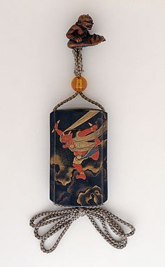 Koma Kyoryu (Japan, died N/A)   Inro, Ojime, Netsuke, late 18th century  Costume/clothing accessory/waistwear, Four-case inro with takamakie, red and gold lacquer on roiro ground of Raiden in sky; amber bead ojime; wood netsuke of sleeping Shojo,