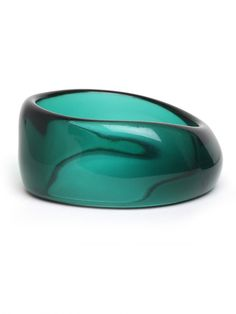 Love the colour and form... not sure whether it's a glass sculpture/paperweight or jewellery—a ring, perhaps?