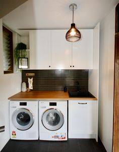 LAUNDRY IDEAS - We custom designed and manufactured this laundry, using crisp white shaker doors, matte black knobs/ handles and a natural timber benchtop. All fitted with Blum soft closing hardware. Laundry Doors, White Laundry Rooms, Modern Laundry Rooms, Laundry Room Layouts, Laundry Closet, Laundry In Bathroom, Timber Benchtop, European Laundry, Kitchen Benchtops
