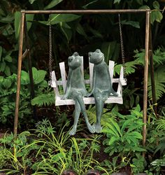 """What better way for frogs to relax than the gentle motion of a swing? Crafted of aluminum with a verdi finish with gold highlights, the frog couple clearly enjoy one another. Swing: 25""""W x 20""""D x 27½""""H. Frogs: 15¾""""W x 9½""""D x 16""""H. 7.65 lbs."""