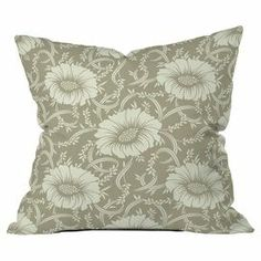 "Woven pillow with a floral motif.  Product: PillowConstruction Material: Woven polyester coverColor: TaupeFeatures:  Zipper closureInsert includedDesigned by Sabine Reinhart for DENY Designs Dimensions: 18"" x 18""Cleaning and Care: Machine wash cover"