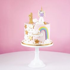 Super cute unicorn birthday cake for little Harriet! How fun is this? Stars, rainbows, sequins and fluffy fondant clouds!