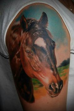c0857d505 A realistic horse head in half-sleeve tattoo. Amazing full color  beautifully shaded, symbolises freedom, life, calm and inspiration.