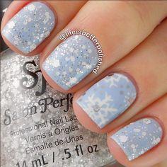 soft blue and glitter snowflake nailart