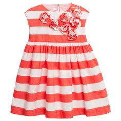 Girls, orange and white striped dress by<span>Il Gufo, made with a smooth cotton and linen blend. It is sleeveless with pretty matching fabric flowers on the front and it fastens with buttons at the back. The slightly flared skirt has gathering around the waist and the smooth cotton lining has a frilled hem, which adds volume.<br /></span> <ul> <li>66% cotton, 34% linen (smooth, lightweight feel)</li> <li>Lining: 100% cotton (smooth feel)</li> <li>Machine wash (30*C)</li> <li>Button fa...