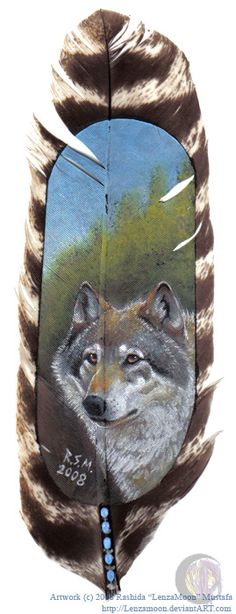 I've grown interested in painting on feathers. Its a new challange for me and this is my first try at painting an animal on a feather. The feather is about 12 inches long and 2.5 inches wide.