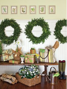 There are so many things I love about this: 1) paint color, 2) the small botanical prints, 3) the plain green wreaths, 4) the bench, 5) the gift wrapping, 6)they shoulder heigth wainscoting and trim....oh my