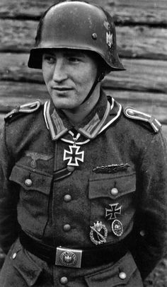 Karl Radermacher (born 1922) was conscripted into the German Army in 1942 and quickly built a reputation as a valiant combat leader. Winning the Iron Cross 2nd class, he went on to complete other heroic deeds and become the recipient of the Knight's Cross and the rare and much sought after Close Combat Clasp in Gold, awarded to him by Himmler personally when he was promoted to lieutenant.Postwar, he worked as a grocer and a bank employee and retired in 1987.