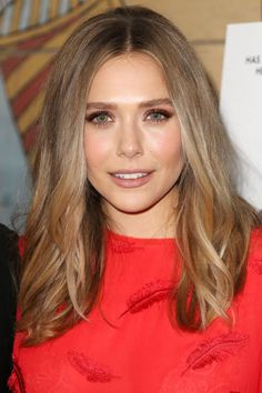 If an allover cool shade isn't for you, try Elizabeth Olsen's fusion approach: She ombrés her cool, natural ash into a warm, toffee hue.