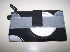 Thirty One Retro Metro Wallet Black Happy DOT by THIRTY ONE. $29.69. THIS BEAUTIFUL RETRO METRO WALLET COMES WITH EXTERIOR ZIPPER POCKET, 12 CARD SLOTS, A CLEAR PVC ID SLOT, 2 BILL SLOTS, AN INTERIOR ZIPPER COMPARTMENT, AND A SNAP CLOSURE.. Save 34%!