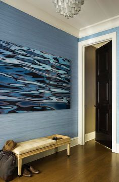 An azure blue fabric wall covering by Maya Romanoff lends texture and vibrancy in this foyer. - Traditional Home ®/ Photo: Eric Piasecki / Design: Gideon Mendelson