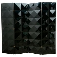 Black plexiglas folding screen  France  1980's  Four-panel screen with plexiglas triangular surface patterns in relief.