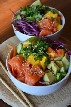 Hawaiian Poke Bowl - Salmon sashimi, papaya, mango, cilantro, avocado, red cabbage, cucumber, rice and a dressing made from soy sauce, fish sauce, olive and sesame oil, honey and lime