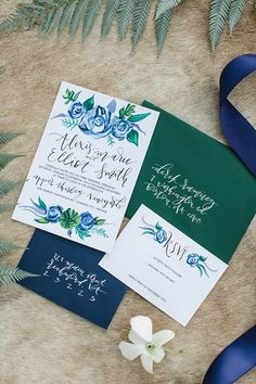 Navy blue and emerald green watercolor winter wedding invitation with white calligraphy