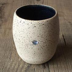 Wheel thrown flecked stoneware beaker inlaid with raw blue sapphire. Approx 7cm  @tuttonandyoung #madelondon #tamaragomezjewellery #rawluxury #spiritinspired #rawbeauty #sapphires #cockpitarts #studiolife #craftfair #onemarylebone #madeinlondon #gemstones  #ceramics #pottery #rawluxury #tamaragomezjewellery #infinityceramics #craftanddesign #londondesign #madeinlondon #turningearth #crossdiscipline #infinityceramics