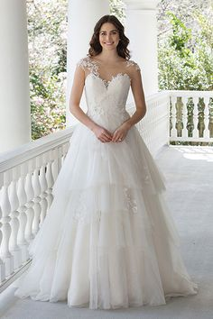 Wedding gown by Sincerity Bridal.
